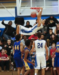 "Eastern's Chance Moore with a ""get the crowd on their feet"" slam dunk against Henry Clay.  Dec. 11, 2015"